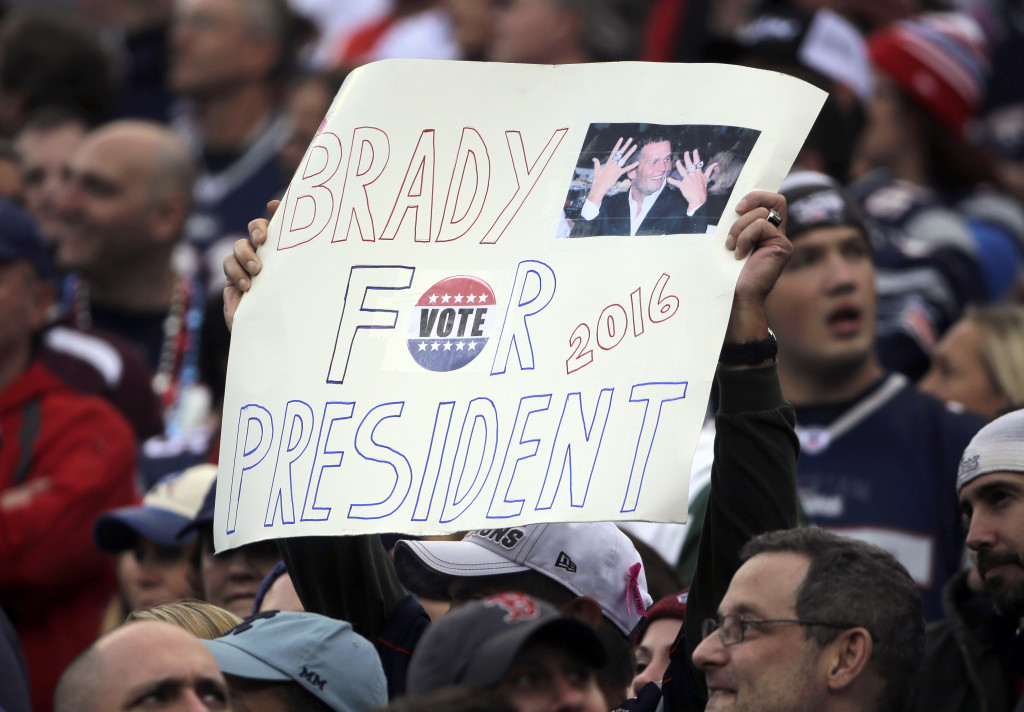 A New England Patriots fan holds a sign that supports Patriots quarterback Tom Brady for president during an NFL football game against the New York Jets in Foxborough, Mass.