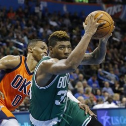 Celtics guard Marcus Smart drives past  Thunder guard Russell Westbrook in the third quarter Sunday. The Associated Press