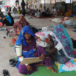 In this June 25, 2015 file photo, people sit outside a local hospital where hundreds of people are admitted suffering from heatstroke and dehydration due to sever weather in Hyderabad, Pakistan. Because of man-made global warming and a strong El Nino, Earth's wild weather this year is bursting the annual heat record, the World Meteorological Organization announced Wednesday. The Associated Press