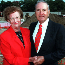 "This 1997 file photo shows Melissa and Richard ""Doc"" Costello at the site where the University of Southern Maine field house was built in their honor. The Costellos' estate has given $1.65 million to the school to help fund improvements to the Costello Sports Complex."