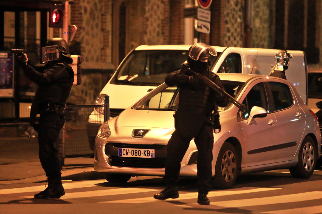 Police forces stage an operation early Wednesday that two officials said is linked to last week's terror attacks in Paris. Authorities in the Paris suburb of St. Denis told residents to stay indoors during the operation. The Associated Press
