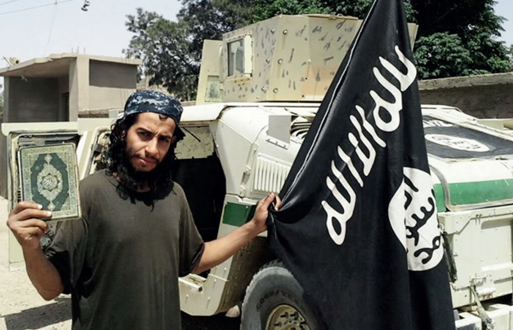 This image made available in the Islamic State's English-language magazine Dabiq shows Belgian national Abdelhamid Abaaoud, who has been identified as the mastermind behind Friday's attacks in Paris. Militant photo via AP