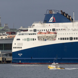 A water taxi makes its way past the Nova Star ferry in Casco Bay Thursday morning. Officials were searching for a Portland Express Water Taxi that went missing Wednesday. Gabe Souza/Staff Photographer