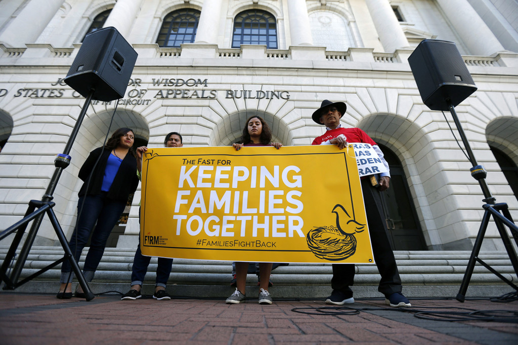Immigration activists protest outside the federal appeals court in New Orleans, Wednesday. The Associated Press