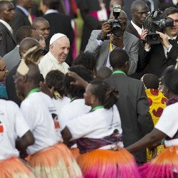 Pope Francis is greeted by traditional dancers on his arrival at the airport in Nairobi, Kenya.