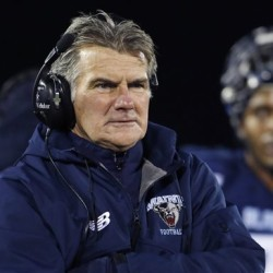 FILE - In this Nov. 22, 2014, file photo, Maine head football coach Jack Cosgrove watches the action during the first half of an NCAA college football game against New Hampshire at Alfond Stadium at the University of Maine in Orono, Maine. Cosgrove said Tuesday, Nov. 24, 2015, he will transition into a senior associate director of athletics position at the school after nearly 23 years of leading the Black Bears. Joe Harasymiak was named interim head coach, and the school said a national search for a head football coach will start immediately. (AP Photo/Robert F. Bukaty, File)