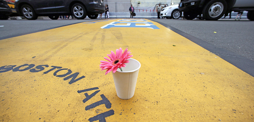 A flower in a cup stands on the finish line of the Boston Marathon after the verdict was reached in the penalty phase of the trial of Marathon bomber Dzhokhar Tsarnaev, in this May 15, 2015, photo. The Associated Press