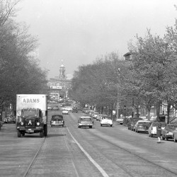 This historic photo of Park Avenue next to Deering Oaks Park, looking towards downtown Portland with the City Hall tower visible on the horizon, originally appeared on the cover of the May 16, 1960 Portland Evening Express.