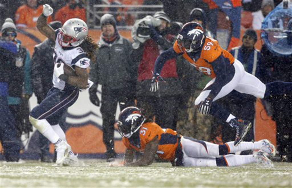 Patriots running back Brandon Bolden breaks free for a touchdown as Broncos strong safety Omar Bolden and linebacker Danny Trevathan pursue in the second half.