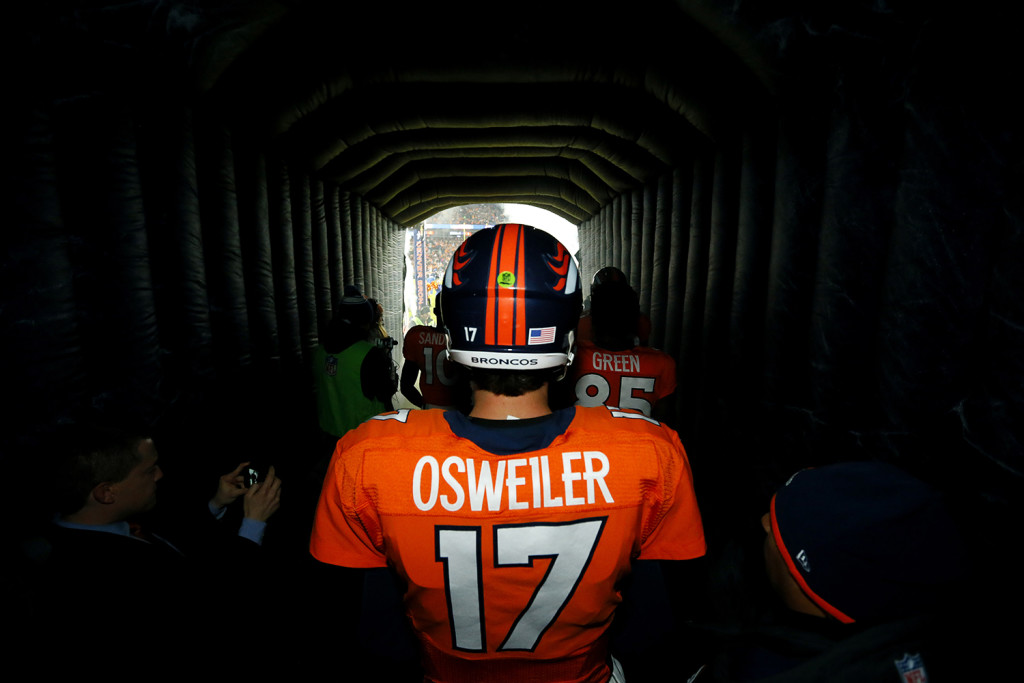 Denver Broncos quarterback Brock Osweiler (17) stands in the tunnel prior to an NFL football game against the New England Patriots, Sunday. The Associated Press