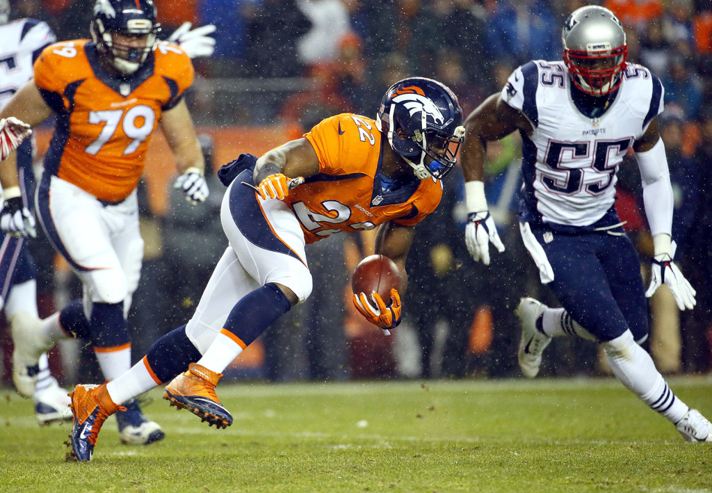 Denver Broncos running back C.J. Anderson (22) runs against the New England Patriots during the first half  Sunday, in Denver. The Associated Press