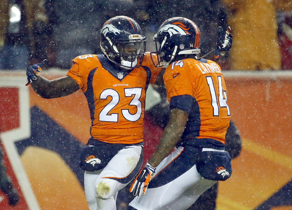 Denver Broncos running back Ronnie Hillman (23) celebrates his touchdown against the New England Patriots with wide receiver Cody Latimer (14) during the first half Sunday. The Associated Press