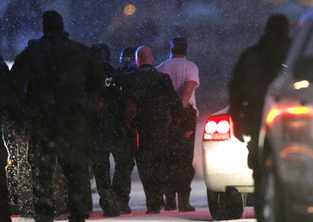 Robert Lewis Dear is taken into custody outside the Planned Parenthood clinic in Colorado Springs after a man stormed the clinic and opened fire in a burst of violence that left three people dead and nine injured, authorities said. Reuters/Rick Wilking