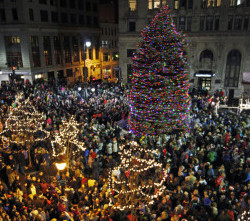 "Monument Square was jammed Friday evening for the annual Christmas tree-lighting celebration, which included a visit from Santa Claus and Rick Charette singing holiday favorites. Temperatures in the 50s pushed turnout above the projected 3,000 people to an estimated 5,000, said city officials. ""It's nice that it's warm because last year it was freezing,"" said Jamie Edwards of Gorham, who attends each year with her young family."