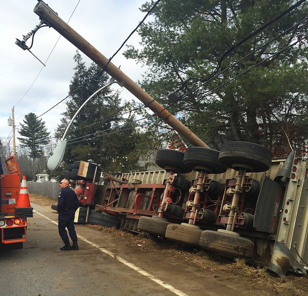 Maine State Police on the scene of a tractor trailer roll-over on Route 35 in Dayton. The driver was transported to the hospital with minor injuries. Photo courtesy of Maine State Police
