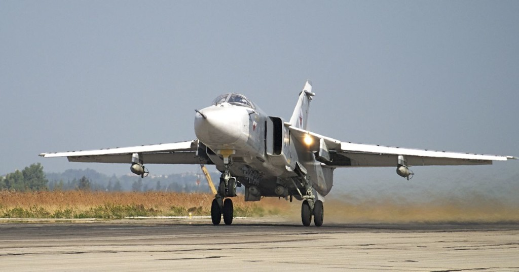 A Russian Su-24 takes off on a combat mission at Hemeimeem airbase, Syria, in this Oct. 22 photo  Russian news agencies say the warplane shot down Tuesday did not violate the Turkish airspace. The Associated Press