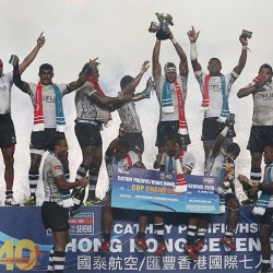 Fiji team celebrates after winning the final match against New Zealand of the Hong Kong Sevens rugby tournament in Hong Kong, Sunday, March 29, 2015. (AP Photo/Kin Cheung)
