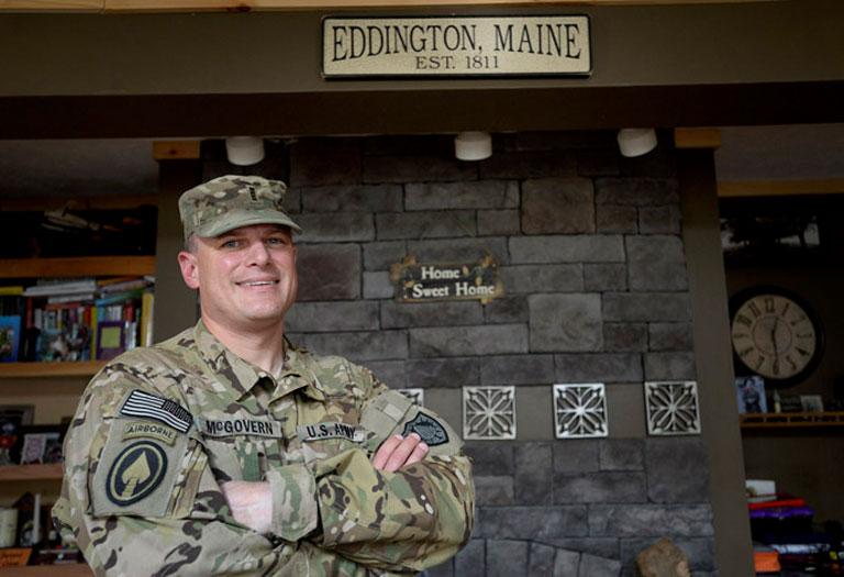Chief Warrant Officer Mike McGovern, seen here at home in Eddington last week, recently returned home from his second tour in Afghanistan. The military pilot has also done tours of duty in Iraq and Bosnia. Shawn Patrick Ouellette / Staff Photographer