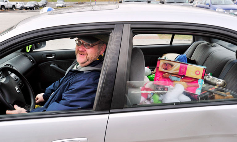 Bil Moriarty, aka Santa Bil, takes a carload of toys from a collection site at the Harold Alfond Forum on the University of New England campus in Biddeford Pool earlier this month. Shawn Patrick Ouellette / Staff Photographer