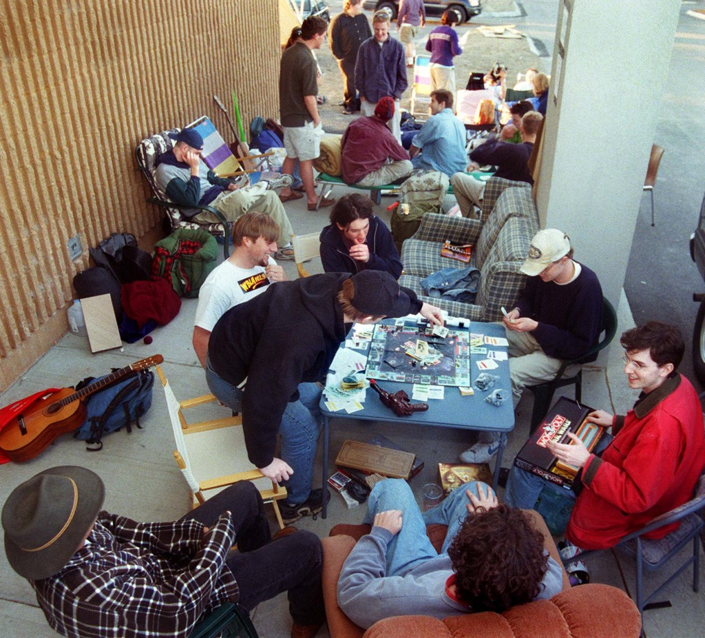 """Eli Meyers, 16, of Yarmouth, picks a card in a game of Star Wars Monopoly that he and a group of Greater Portland Star Wars fans are playing while waiting in line for tickets to """"Star Wars: A Phantom Menace"""" at the Falmouth Hoyts Cinemas on May 11, 1999."""