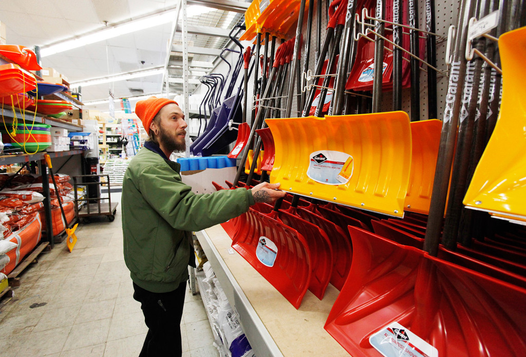 Patrick Libby selects a snow shovel to buy Monday at Maine Hardware in Portland, in preparation for Tuesday's storm. Libby moved to Portland from Florida in June. Joel Page/Staff Photographer