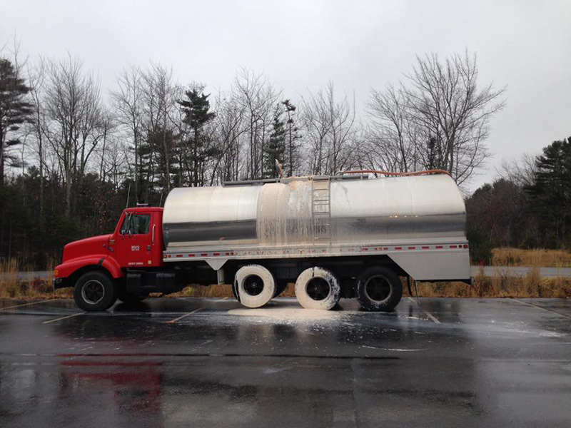 A milk truck parked overnight at Yarmouth's Exit 15 Park and Ride. The tank was overfilled, causing what seemed to be a suspicious liquid to overflow.