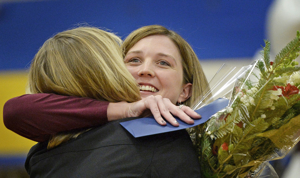 Saco Middle School eighth-grade science teacher Michaela Lamarre gets a hug from Principal Laurie Wood after Lamarre received the Milken Educator Award and $25,000 on Thursday morning. Shawn Patrick Ouellette/Staff Photographer