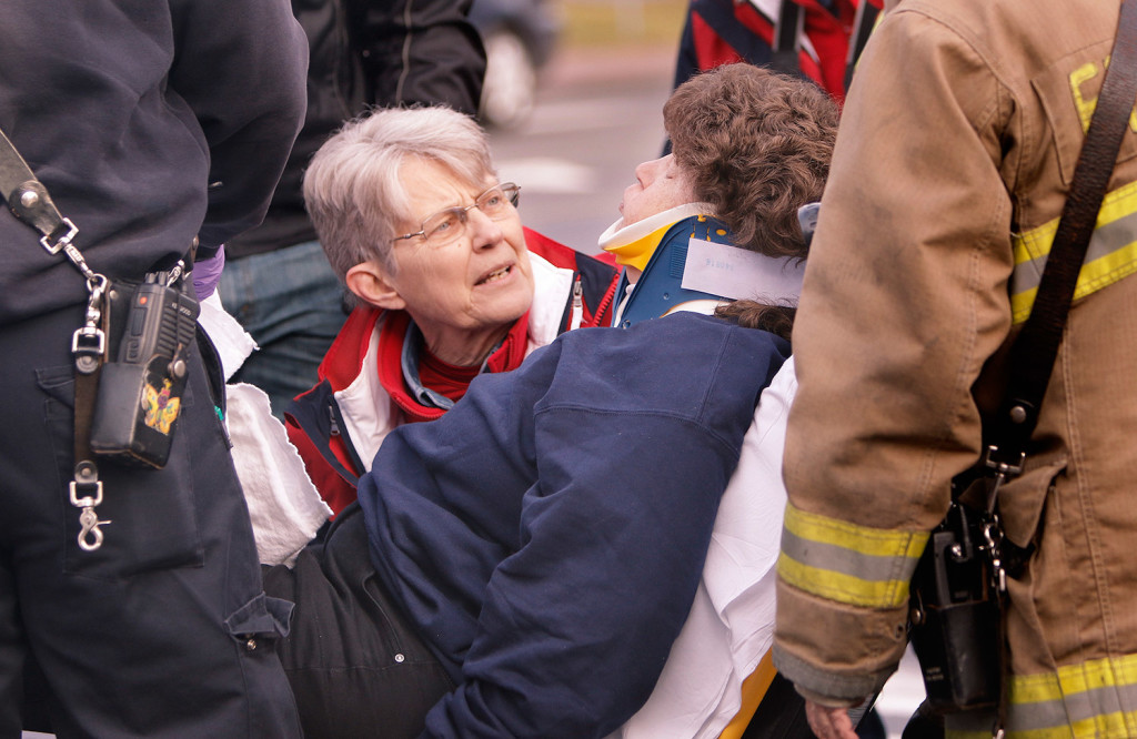 Elaine Greene, one of the Freeport Flag Ladies, talks with Rhoda O'Leary, a supporter of the Flag Ladies who was struck by an SUV while crossing School Street.