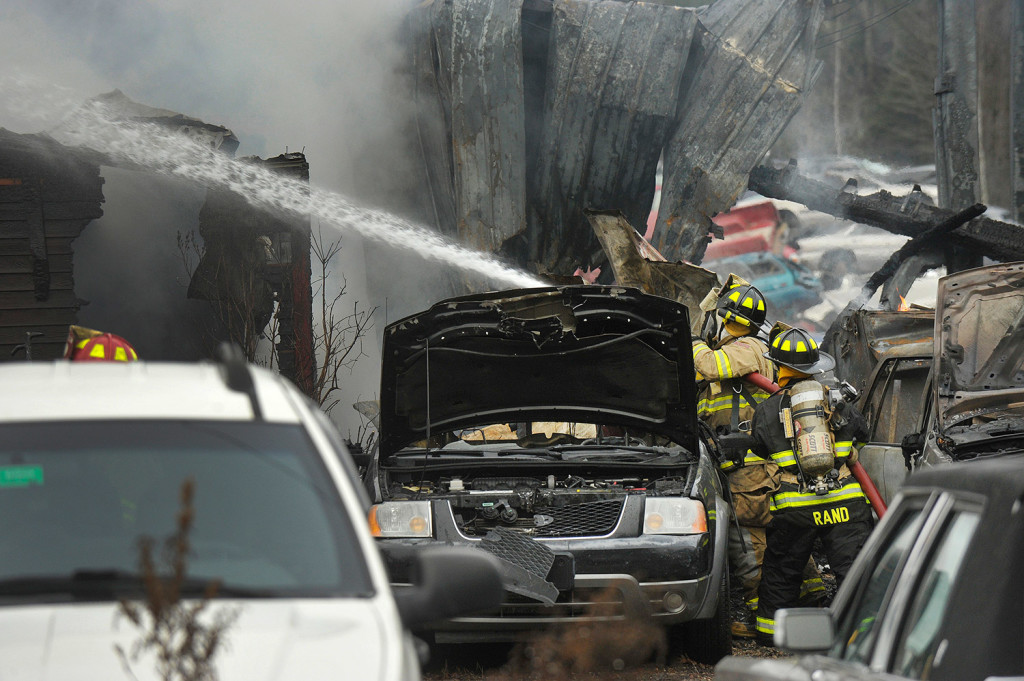 Firefighters douse hot spots during Thursday's fire in Bridgton. John Ewing/Staff Photographer