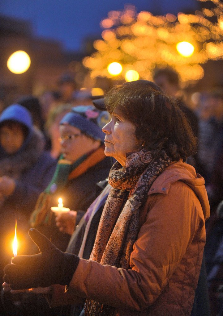 Barbara Taylor of Peaks Island participates in Monday's vigil, which marked a record number of deaths in Portland's homeless community.