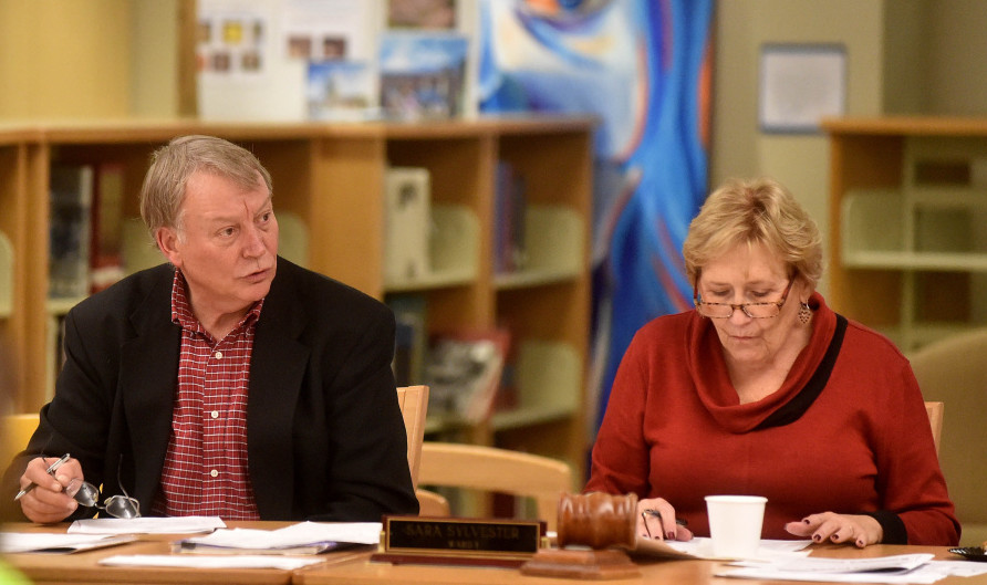 Superintendent Eric Haley, left, conducts a school board meeting at Waterville Senior High School on Wednesday night.