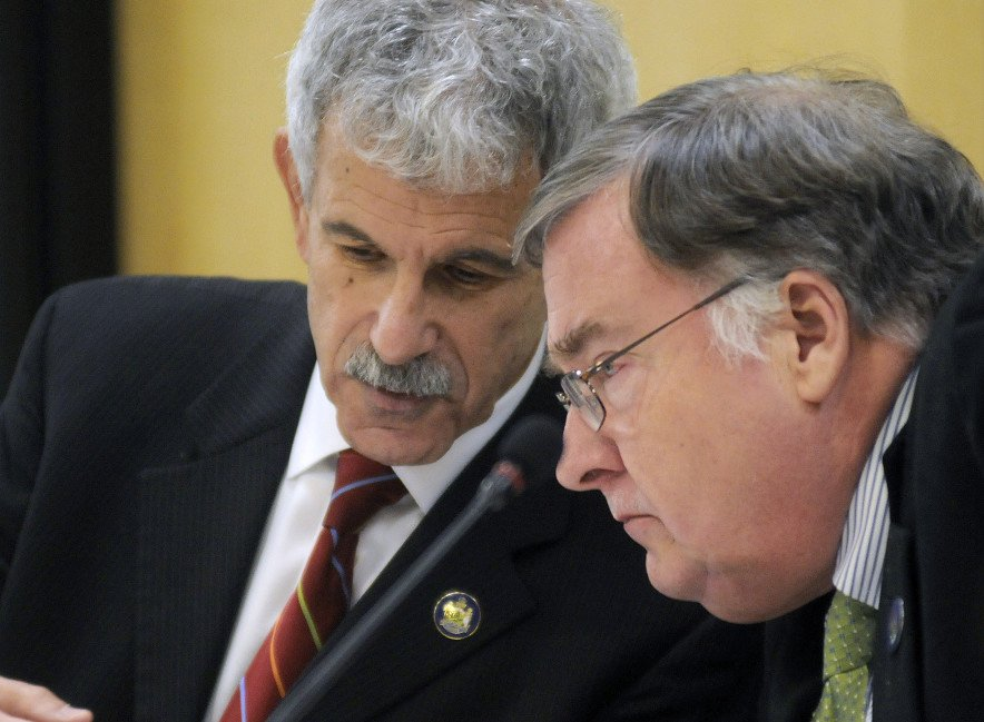 The Legislature's Government Oversight Committee chairs Sen. Roger Katz, R-Augusta, left, and Rep. Chuck Kruger, D-Thomaston, confer during a debate Thursday in Augusta about a probe conducted into the termination of Speaker Mark Eves at Good Will-Hinckley.