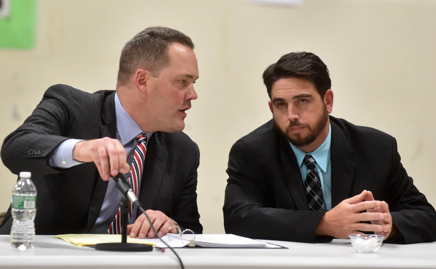 Gregg Frame, left, confers with his client, Don Reiter, during the Waterville school board hearing on his dismissal last month. The board fired Reiter Nov. 16 and his lawyer said Tuesday he won't appeal the dismissal.