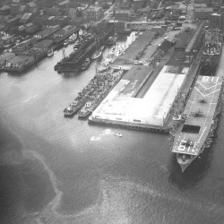 A June 1949 aerial photograph of the Portland waterfront shows the USS Sicily, an aircraft carrier, berthed at the Maine State Pier.
