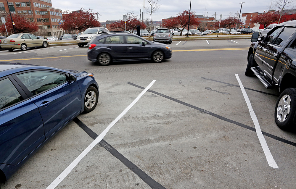 Adding to the confusion about the new angled parking spots on Spring Street, is that the lines were painted at the wrong angle initially on one side of the road.  Derek Davis/Staff Photographer
