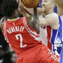 Pistons guard Steve Blake, right, and Rockets guard Patrick Beverley battle for the ball Monday in Auburn Hills, Michigan.