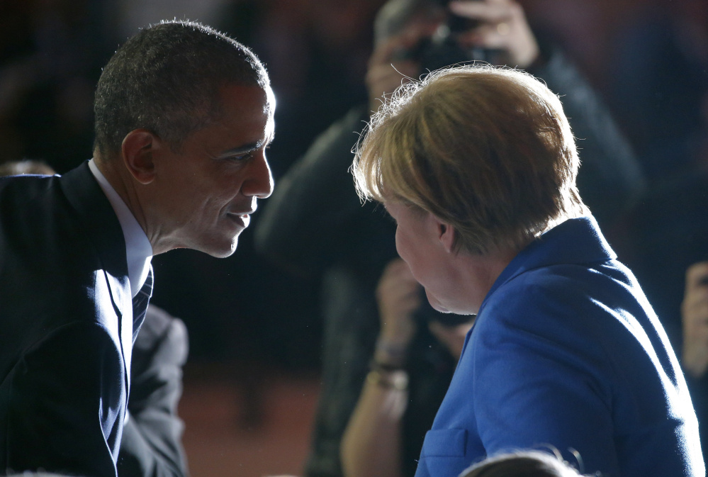 "President Obama talks with German Chancellor Angela Merkel at the climate conference Monday. French Foreign Minister Laurent Fabius opened the 150-nation summit, saying ""the menace of climate change is too great for us to be content with a minimalistic agreement."" Stephane Mahe/Reuters"