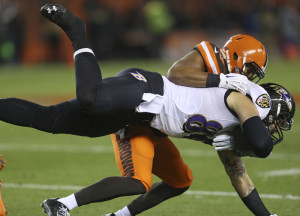 Ravens tight end Crockett Gillmore is tackled by Browns linebacker Craig Robertson in the first half Monday in Cleveland.