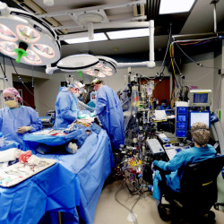 A surgery takes place last year in a crowded operating room at Maine Medical Center. New federal figures show spending on health care rose more in Maine than the nation as a whole from 2004 to 2014, from $4,727 to $7,289 per person, probably because of the state's older population.