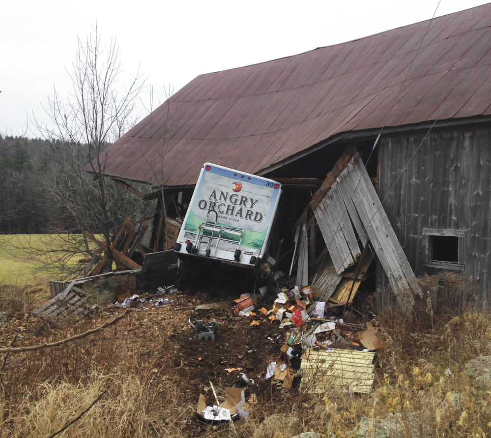 FILE – Police say this Angry Orchard truck was stolen from a Portland convenience store and spotted by a York County deputy before it crashed into a barn in Limerick on December 1, 2015.
