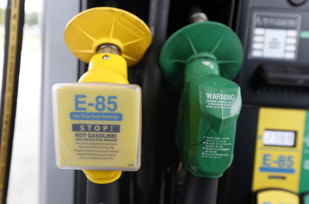 A fuel nozzle for E-85, an ethanol-gasoline blend, is on the left of a nozzle for traditional gasoline at a gas station in Batesville, Miss.