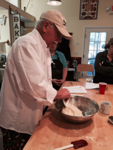 Michael Jubinsky shows students how to work with dough.