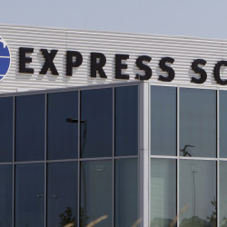 Express Scripts will make a treatment costing $1 per pill available on its biggest list of covered drugs, as an alternative to a pill that rose in cost from $13.50 to $750.