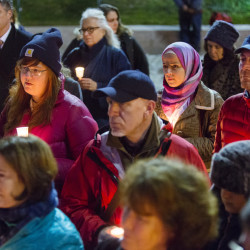 People gather in Monument Square in Portland on Tuesday for a candlelight vigil in memory of those killed in the Colorado Springs Planned Parenthood shooting.