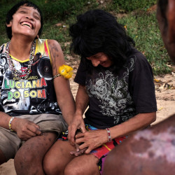 Wirohoa, right, flirts with his wife, Ximirapi, in the indigenous village of Tiracambu, Brazil, last August. Until recently, Wirahoa, who belongs to the Awá tribe, lived as a nomadic hunter/gatherer in the forest with his mother and aunt.