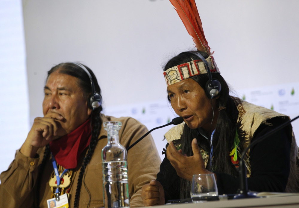 Protecting forests can mitigate the effects of worldwide climate change, indigenous leaders Tom B.K. Goldtooth of Bemjdji, Minnesota, left, and Gloria Hilda Ushiqua-Santi of the Ecuadorian Amazon rainforest stress at the United Nations Climate Change Conference in LeBourget, France, Tuesday. The conference continues until next week.