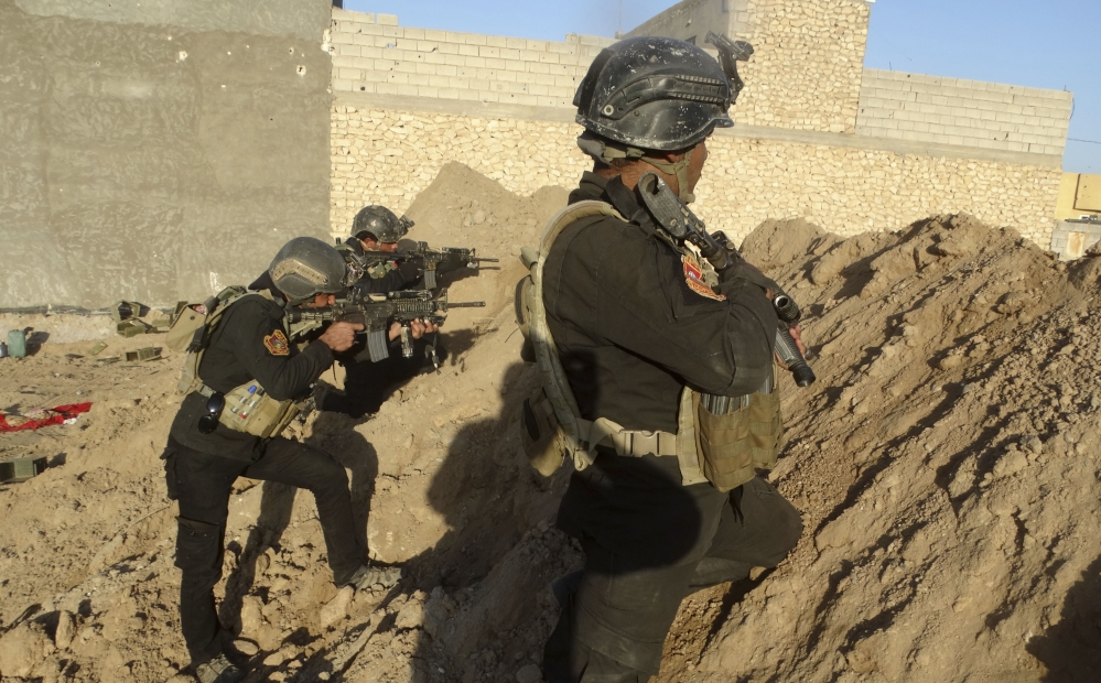 Iraqi forces take combat positions around Ramadi. Iraq's military command warned civilians to leave the city but residents say extremists will arrest or kill them if they try.