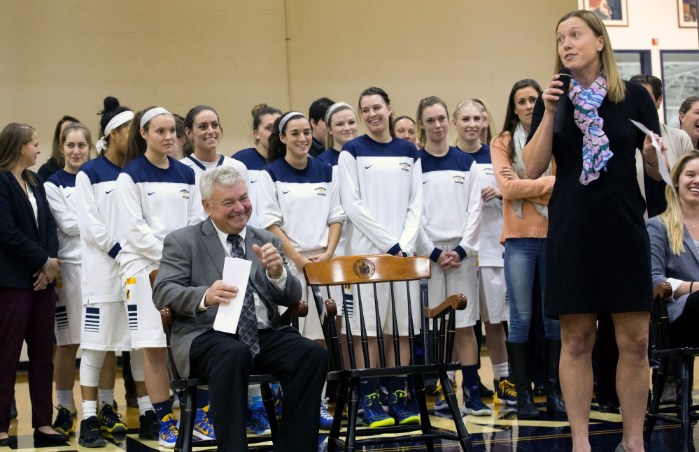 "Gary Fifield laughs as one of his former players, Julie Plant, speaks at a dedication ceremony Tuesday night in Gorham. USM honored its former coach by naming the basketball court the Fifield Court at Hill Gymnasium. ""It's really, really very special,"" said Fifield."