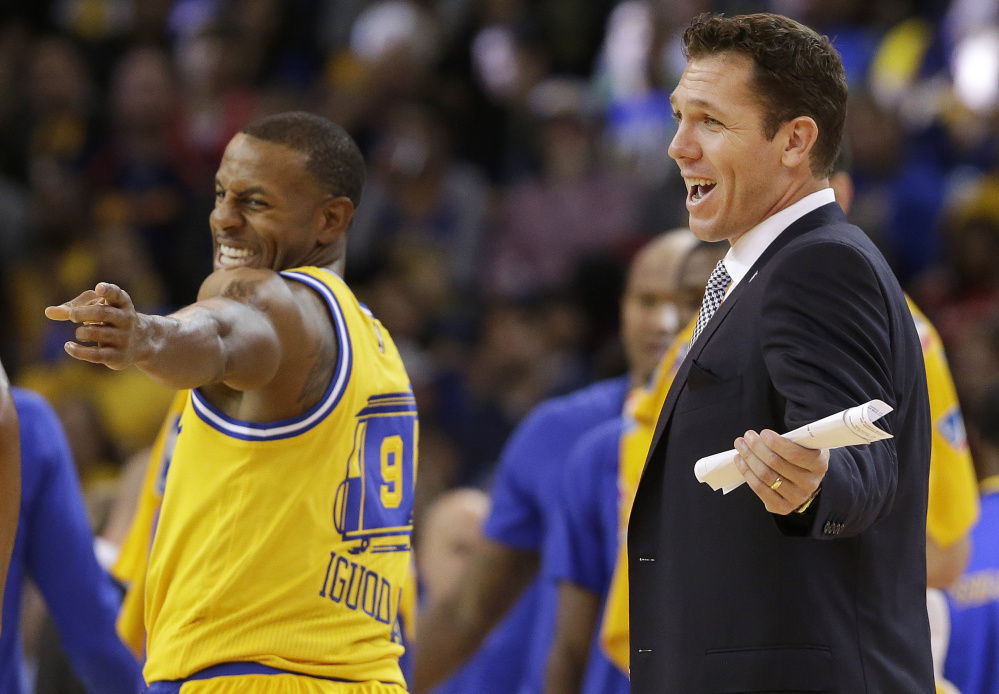Nothing but smiles around the Golden State Warriors these days, whether it's Andre Iguodala, left, or interim coach Luke Walton, who has run the team while Steve Kerr recovers from back surgery. Walton has learned from the best, using time while sidelined with an injury to watch and listen to Phil Jackson, his coach with the Lakers.