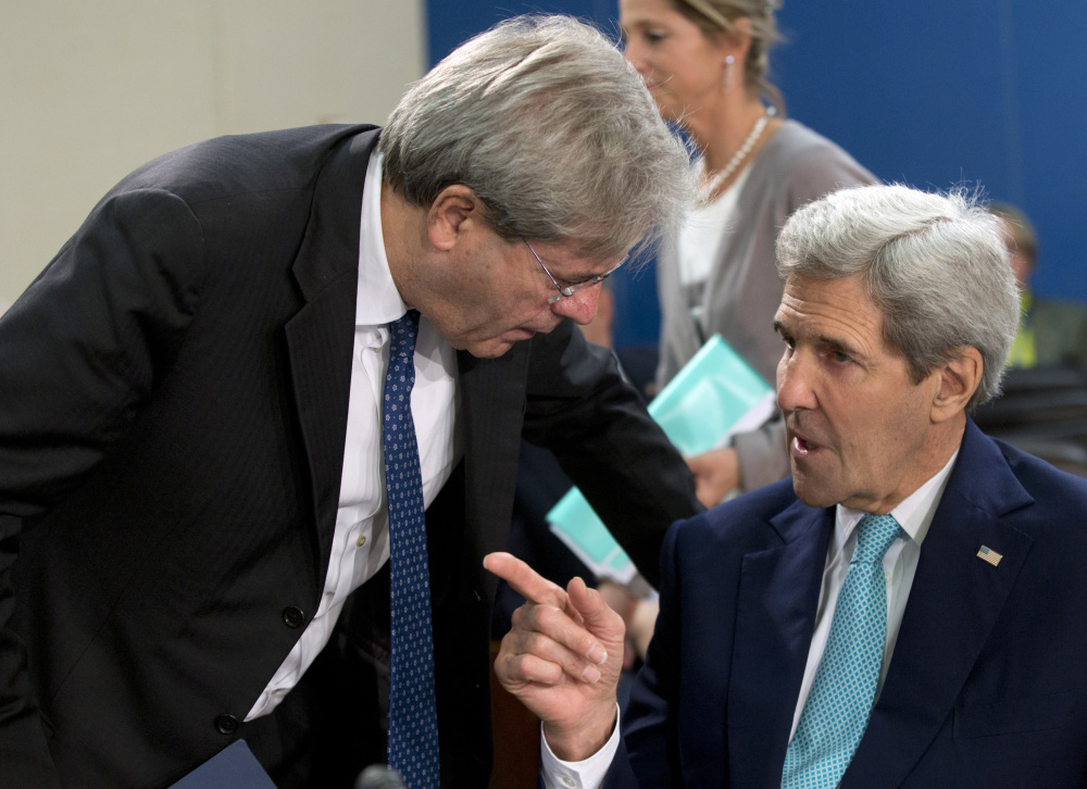 U.S. Secretary of State John Kerry, right, speaks with Italian Foreign Minister Paolo Gentiloni during a meeting of the NATO-Ukraine Commission at NATO headquarters in Brussels on Wednesday.